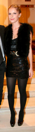Eugine Niarchos in a statement fur vest with her LBD